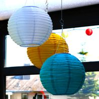 Hanging up paper lanterns and wind chimes